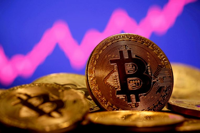 Bitcoin drops after Elon Musk tweets broken-heart emoji for token, Companies & Markets News & Top Stories