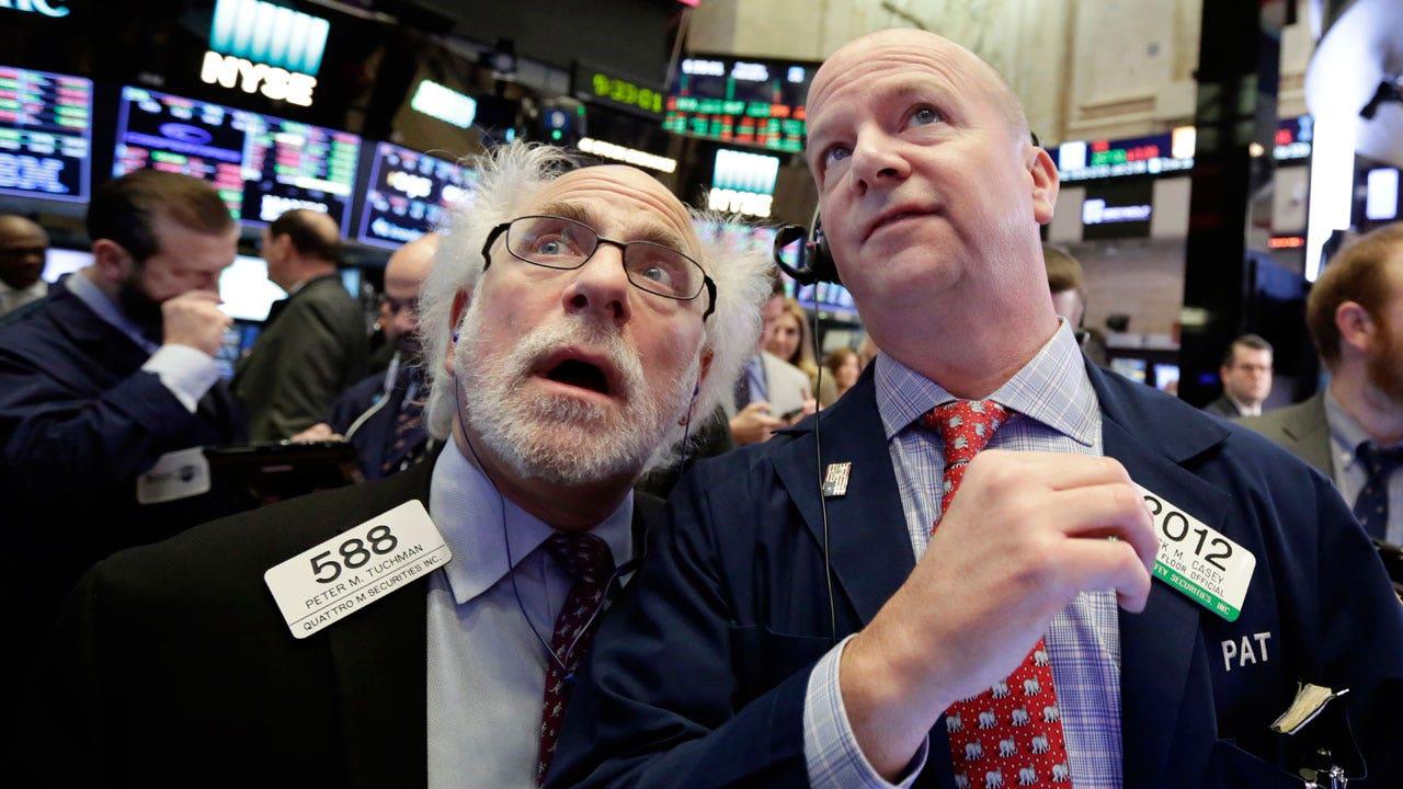 Stocks hit records ahead of Tesla earnings